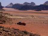 Overland Truck at Wadi Rum, Wadi Rum National Reserve, Aqaba, Jordan Photographic Print by Jane Sweeney