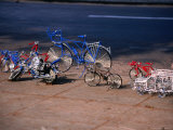 Metal Wire Bicycles and Toys for Sale on City Streets, Maputo, Mozambique Photographic Print by Rick Gerharter