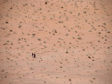Two Distant People Walking Desert of Wadi Rum, Wadi Rum National Reserve, Aqaba, Jordan Photographic Print by Jane Sweeney