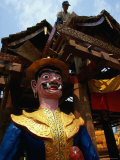 Buddhist Monastery Statue and Worker at Xishuangbanna, Yunnan, China Photographic Print by Diana Mayfield