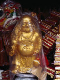 Gold Buddha for Sale Wrapped in Plastic, Melaka, Malaysia Fotografie-Druck von Richard I&#39;Anson
