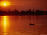 Fisherman Heading Out for Night Fishing Under Mekong River Sunset, Si Phan Don, Laos Photographic Print by Woods Wheatcroft