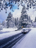 A Laden Car on Snowy Winter Roads, Yosemite National Park, California, USA Photographic Print by Thomas Winz