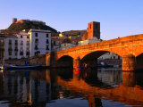 Pontevecchio Bridge Reflected in the River Temo with Castella Malaspina, Bosa, Sardinia, Italy Photographic Print by Doug McKinlay
