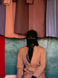 Woman with Covered Face Sitting in a Shop, Kashgar, China Photographic Print by Keren Su
