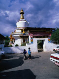 Boys Outside Memorial Chorten, Thimphu, Bhutan Photographic Print by Nicholas Reuss