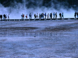 Hikers Walking along a Boardwalk at Midway Geyser Basin, Yellowstone National Park, USA Photographic Print by Brent Winebrenner