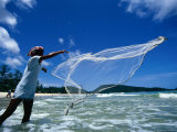 Fisherman Casts His Drift Net off Patong Beach, Patong, Phuket, Thailand Photographic Print by Tom Cockrem