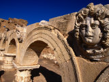 Gorgon Medusa Head on the Arches of the Severan Forum, Leptis Magna, Al Khums, Libya Photographic Print by Doug McKinlay