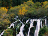 Waterfall Cascading in a Forest in Nine Village Valley, China Photographic Print by Keren Su
