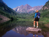 Hiker Stands on a Rockoverlooking Maroon Bells, Aspen, Colorado, USA Photographic Print by Cheyenne Rouse