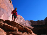 Hiker Standing on a Ledge at Lake Powell, Utah, USA Photographic Print by Cheyenne Rouse