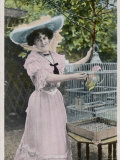 The Popular Actress Marie Studholme Poses with Her Pet Parrot in Its Cage Photographic Print