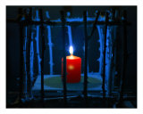Candle In A Cage Photographic Print by John Fitzgerald