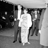 Peter O'Toole with Miss Buck at a Film Premiere, February 1965 Photographic Print