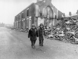 Two Boys Walk Past the Partially Demolished Row of Terrace Houses in Blackburn, May 1987 Photographic Print