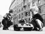 Two Boys Playing with a Remote Controlled Tank Photographic Print