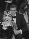 Roger Moore Meets Miss Piggy from the Muppets Photographic Print