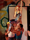 Kylie Minogue Performing at Her Concert, She is Being Held up by Two of Her Dance Troop Photographic Print