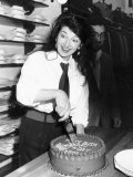 Kate Bush Cuts Her 30th Birthday Cake at Blazers Boutique Photographic Print