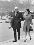 Telly Savalas Walking Arm in Arm in London with His Wife, Marilynn Gardner, February 1968 Photographic Print