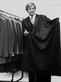 Roger Moore Holding a Length of Suiting Cloth, October 1970 Photographic Print