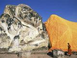 Thailand, Ayutthaya Historical Park, Wat Lokaya Sutha, Monk Preying at Giant Reclining Buddha Photographic Print by Steve Vidler
