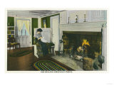Maine - Interior View of a New England Homestead, Woman by the Fireplace Posters