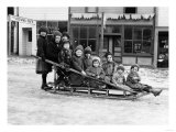 Children Playing on Sleigh in Seward, Alaska Photograph - Seward, AK Posters by  Lantern Press