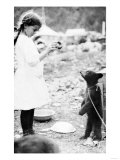Girl Feeding Bear Cub in Seward, Alaska Photograph - Seward, AK Prints