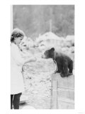 Girl Playing with Bear Cub in Seward, Alaska Photograph - Seward, AK Prints