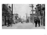 Front Street in Nome, Alaska covered with snow Photograph - Nome, AK Prints by  Lantern Press