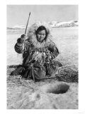Eskimo Woman Fishing through Ice in Alaska Photograph - Alaska Posters
