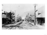 View of a Train Entering Town - Skagway, AK Posters