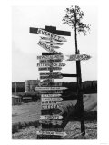 Signpost at Watson Lake, Alaska on Alaska Highway Photograph - Watson Lake, AK Posters by  Lantern Press