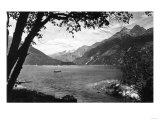 Skagway, Alaska Harbor with Fishing Boat Photograph - Skagway, AK Posters by  Lantern Press
