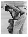 African American Man Comforts Crying Child Photograph Affischer