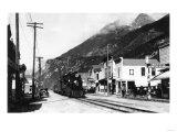 White Pass Train on Broadway St. Skagway, AK Photograph - Skagway, AK Prints by  Lantern Press