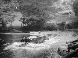 1925 Lancia Lambda Driving Through a Shallow River Photographic Print