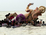 Devotees Immerse a Giant Clay Idol of Hindu Elephant-Headed God Ganesh into the Arabian Sea, Bombay Photographic Print