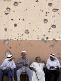 Lebanese Residents Rest in Front of a Wall Photographic Print