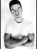 Pop Idol Judge Simon Cowell Poses Smoking a Cigarette at Max Clifford's Office London Photographic Print