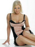 Suzanne Shaw Wearing a Black and Peach Corset Style Dress Sitting on the Floor Photographic Print
