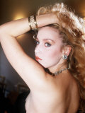 Jerry Hall Wearing Backless Dress and Bracelet with Her Hand on Her Head Photographic Print
