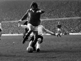 Manchester United's George Best is Challenge by Stoke Defender March 1972 Photographie