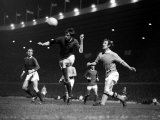 George Best Heads the Ball Clear December 1969 Watched by Pat Crerand and Ina Bowyer Photographic Print