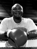 George Foreman Boxer in Ring Leaning on Ropes Photographic Print