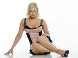 Suzanne Shaw Wearing a Black and Peach Corset Style Dress Sitting on the Floor Fotografisk tryk
