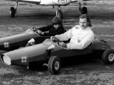 Racing Driver Graham Hill with Son Damon at Elstree Aerodrome in Toy Racing Cars Photographic Print