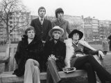 Rolling Stones Sitting on Bench in Park Photographic Print